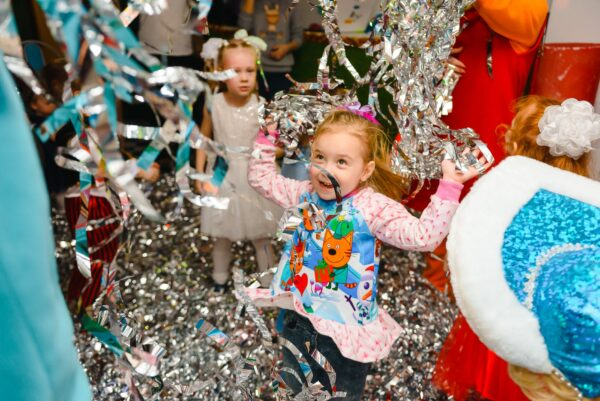 photo of girl having fun in birthday party