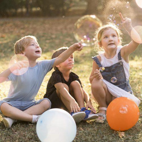 full-shot-kids-playing-outdoors