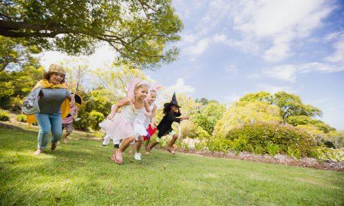 Happy children racing in the park